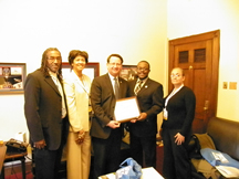 Congressman Gary Peters (D-9) receives the Distinguished Community Health Superhero award from The Wellness Plan Health Centers on behalf of NACHC.
