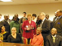 Senator Debbie Stabenow (D-MI) receives the Distinguished Community Health Champion award from Michigan Community Health Center representatives on behalf of NACHC.