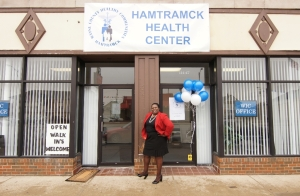"Photo by: Paul Gomez  Edith Killins, Director, Wayne County Health and Human Services Department, poses in front of the new Wayne County ""Healthy Communities"" Hamtramck Health Center located at 11447 Joseph Campau in Hamtramck."