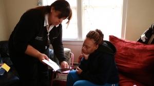 A CHW assists a client. Photo by James Graessle, 2012.