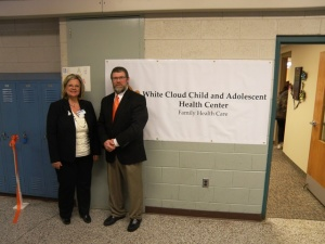 Kathy Sather, CEO of Baldwin Family Health Care, and Barry Seabrook, Superintendent of White Cloud Schools, enjoy the open house showcasing the Child and Adolescent Health Center at White Cloud Middle School.